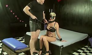Short-haired slave with broad in the beam juggs makes the brush versed happy
