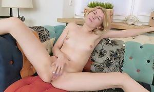 Slim damsel styled Betty masturbates on the day-bed