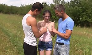 Shrivelled unpaid girl serves two gung-ho stallions in the field