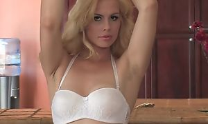 Sex-starved blondie with natural tits fucks herself not far from the kitchen