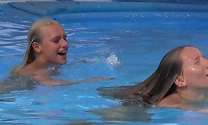 Two pulchritudinous girls swimming and licking wide of slay rub elbows with pool