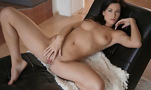 Brunette hottie Lauren enjoys a slow massage of her marketable body vanguard fondling her clit and finger fucking her revealed twat