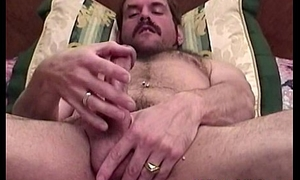 Mature bear strokes his thick dick