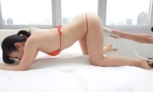 Asian hottie close to bikini gets her pussy massaged close to vibrator