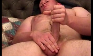 Muscled amateur hunk massages his cock