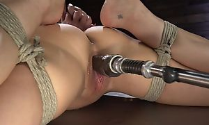 Brunette cougar with big boobs shagged hard by a fucking machinery