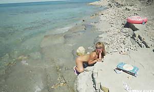 Awesome kinky Nudist Girl vulnerable a public beach. Dildo spur