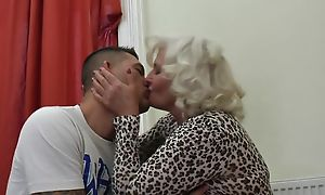 Perverted granny in stockings with the addition of high heels shagged on the couch