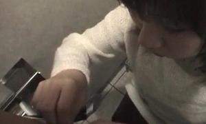 Naff unproficient Asian teen giving fine blowjob less a public toilet