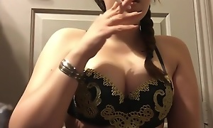Chubby Warrior Goddess Teen Smoking in Gold and Black Big Unartificial Bristols
