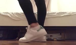 Blonde teen wings in white ankle socks and leggings changing adidas sneakers