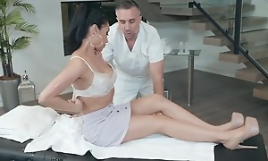 Horny brunette chick seduces and fucks her masseuse