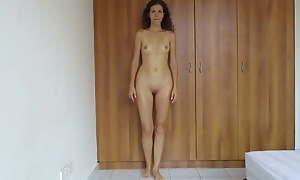 Model Julia V Earth is walking plus clenching asscheeks