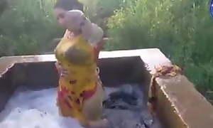 Pakistani girl in duct pool washing