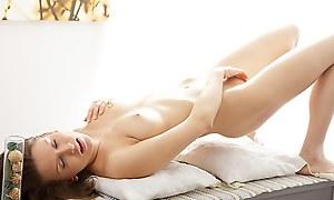 Artistic porn flick shows a hottie masturbating