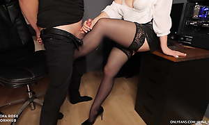 Secretary in stockings gives handjob to boss and gets cum on the top of her feet